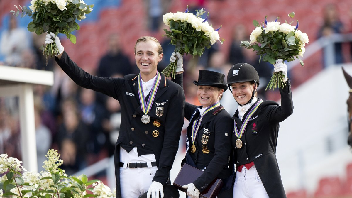 Sonke Rothenberger (zilver), Isabell Werth (goud) en de Deense Cathrine Dufour, die brons pakte. foto: FEI | Richard Juillart