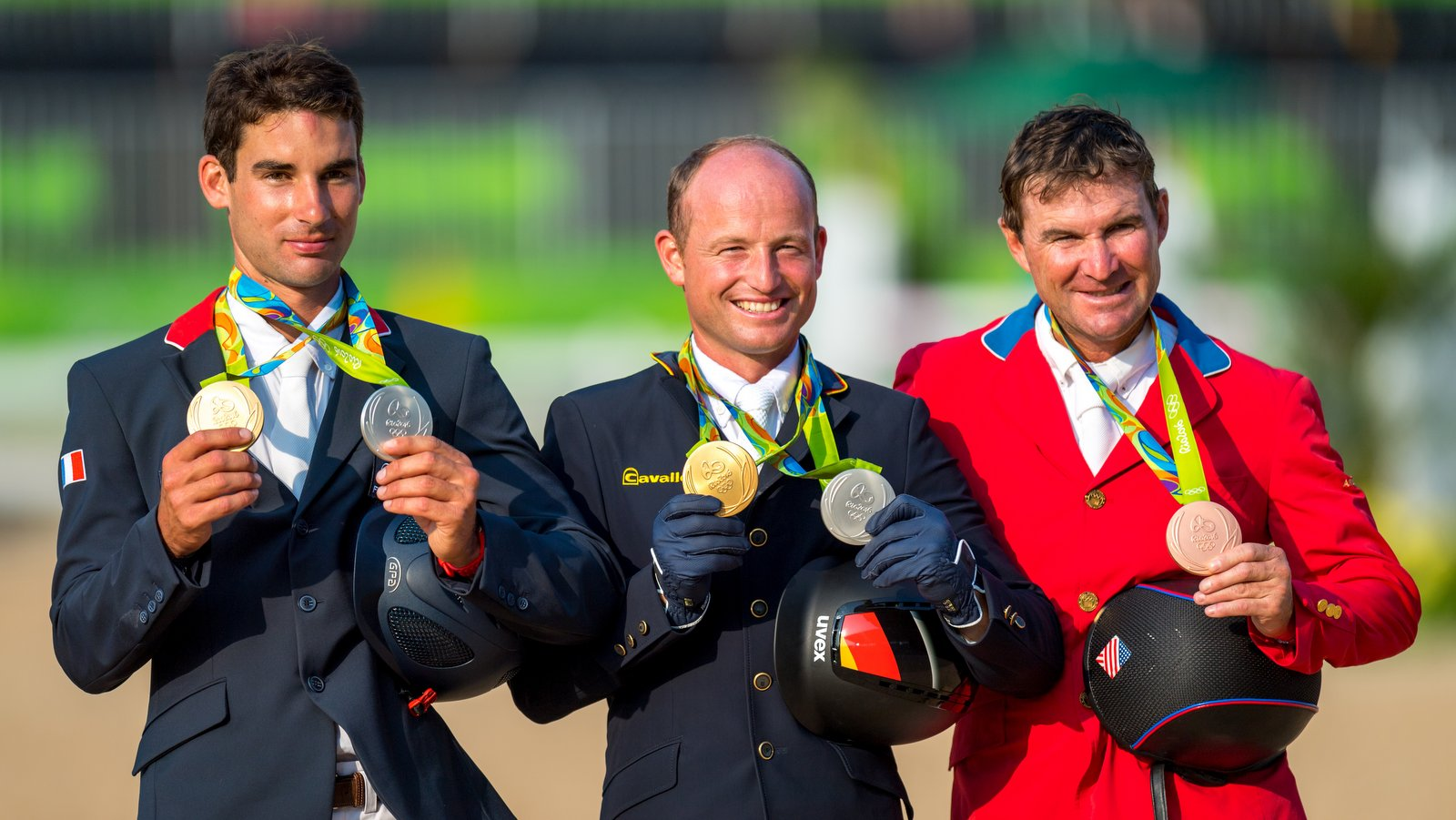 Het individuele podium bij de eventing. Links Nicolas Astier (zilver), midden Michael Jung (goud) en Philip Dutton (brons). foto: FEI | Arnd Bronkhorst